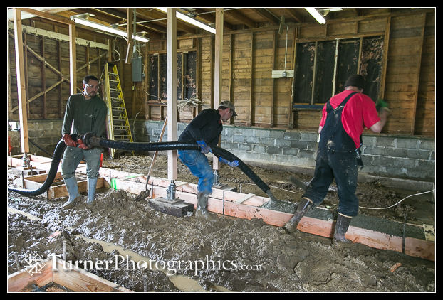 A-1 Builders crew pours concrete for new footers