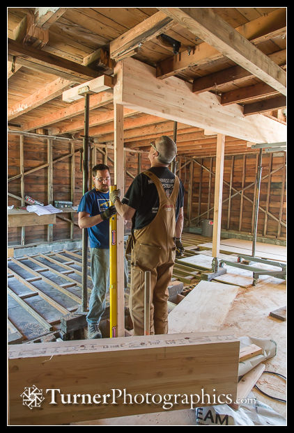 Mike Gill and Dennis check horizontal position of glulam