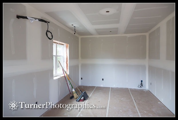 Reception and sales room with drywall taping complete