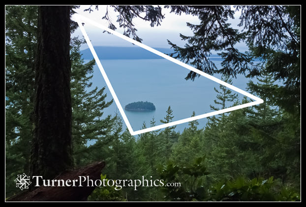 A triangle forms the frame around the main subject in a landscape.