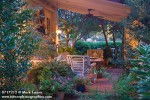 0717212 Covered outdoor sitting area w/ ferns, Impatiens, Basil fgnd, dusk [Impatiens walleriana; Ocimum basilicum]. Turman, Oklahoma City, OK. © Mark Turner