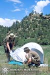 Pitching tent at Anasazi camp.