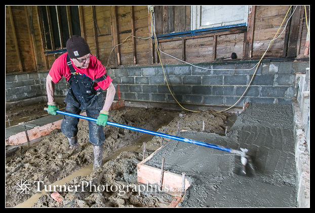 Mike Gill smooths concrete footer