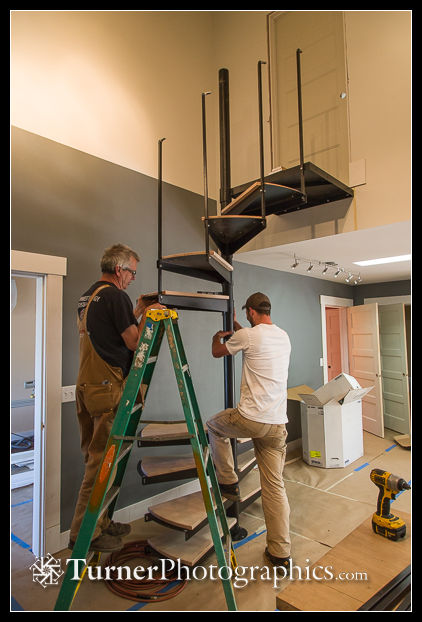 Mike Gill and Matt attach spiral staircase treads