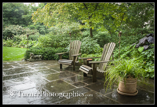 Garden chairs on awet flagstone patio