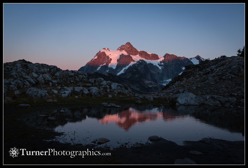 Mt. Shuksan reflected in small tarn at sunset
