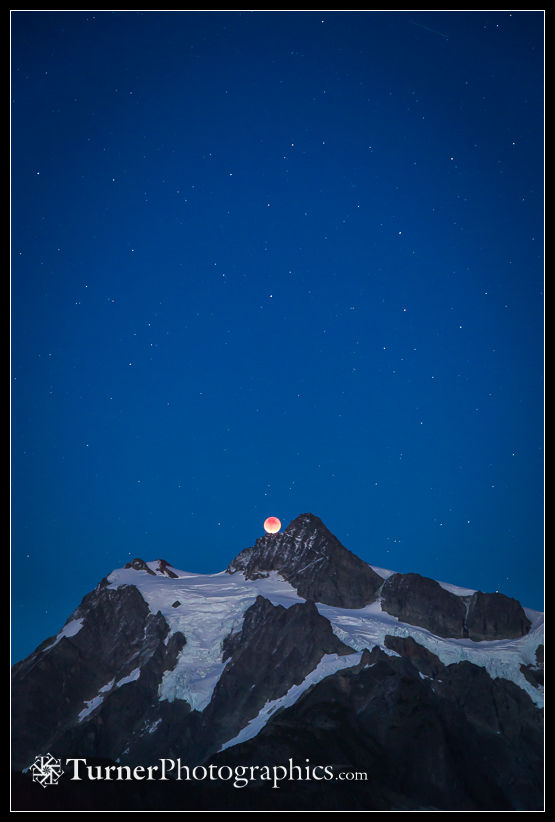 Lunar eclipse rising over Mt. Shuksan